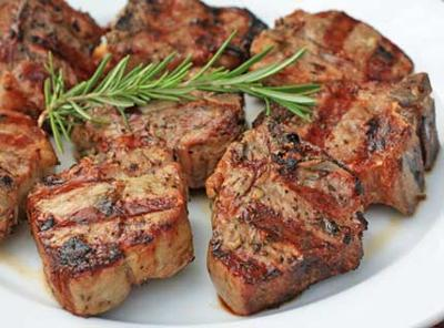 Lamb chops and Rosemary Complement each other in favor