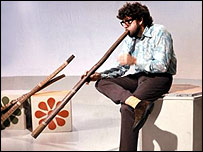 Rolf Harris made the digaridoo well known in the UK in his long career as an entertainer/artist/broadcaster