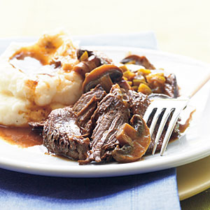 This slow cooker beef pot roast is ideal comfort food served with mashed potatoes to soak up the sauce